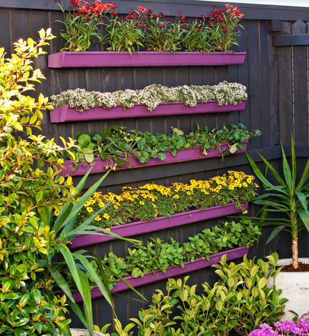 DIY Projects - How to build a Gutter Vertical Garden Planter via BHG