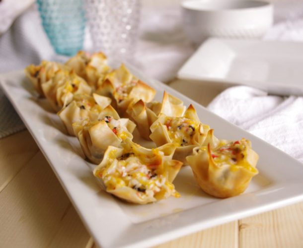 Crab and Cheddar Won Ton Purses Appetizer Easy Recipe - Party Favorites - Yummy Bite sized Crowd-Pleasers #crabandcheddarwontons #crabwontons #easyappetizers #appetizer #fingerfood #horsdoeuvres #tapas #partyfood #bitesizefood #newyearseve #tailgating #potluck #superbowl