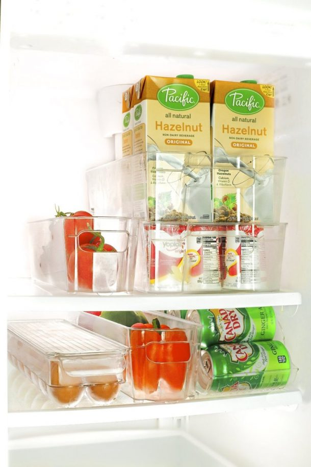 Tips to Organize Every Room in the House - Use Clear Fridge and Freezer Bins to keep your food organized and accessible #kitchenorganization #kitchenhacks #kitchentips #kitchenideas #organizationtips #organization #organizationideas