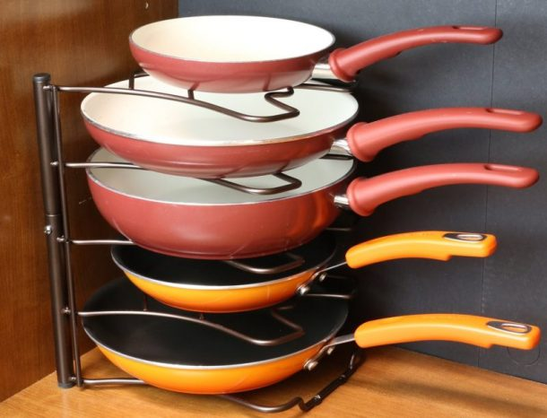 Tips to Organize Every Room in the House - Use a Pan Organizer in Kitchen Cupboards to keep pans from clanking around and to keep them organized #kitchenorganization #kitchenhacks #kitchentips #kitchenideas #organizationtips #organization #organizationideas