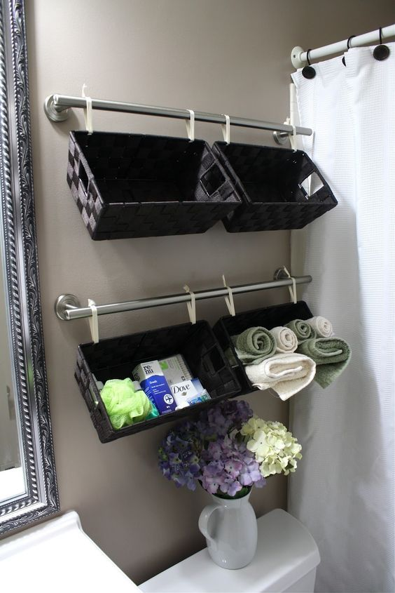 Easy inexpensive do it yourself ways to organize and decorate your diy bathroom organization ideas create a wall full of basket organizers over the toilet for solutioingenieria Image collections