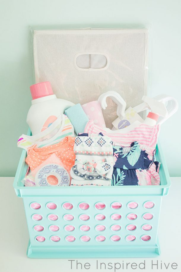 Darling DIY Laundry Basket Baby Shower Gift Basket idea via The Inspired Hive -Do it Yourself Gift Baskets Ideas for All Occasions #giftbaskets #giftbasketideas #diygiftbaskets #gifthampers #easygifts #giftideas #birthdaygifts #diybirthdaygifts #birthdaygiftideas