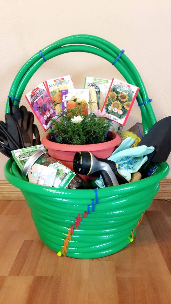 Cute idea for a Gardening Lover or New Homeowner Housewarming DIY Garden Gift! Make the basket itself from garden hoses - Do it Yourself Gift Baskets Ideas for All Occasions - Perfect for Christmas - Birthday or anytime - #giftbaskets #giftbasketideas #diygiftbaskets #gifthampers #easygifts #giftideas #birthdaygifts #diybirthdaygifts #birthdaygiftideas