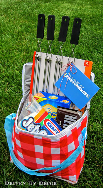 Use a Soft Cooler and S'mores Supplies for the cutest DIY Gift Basket idea via Driven by Decor - Do it Yourself Gift Baskets Ideas for All Occasions - Perfect for Teacher Appreciation, Thank You, Christmas, Birthdays or anytime! #giftbaskets #giftbasketideas #diygiftbaskets #gifthampers #easygifts #giftideas #birthdaygifts #diybirthdaygifts #birthdaygiftideas