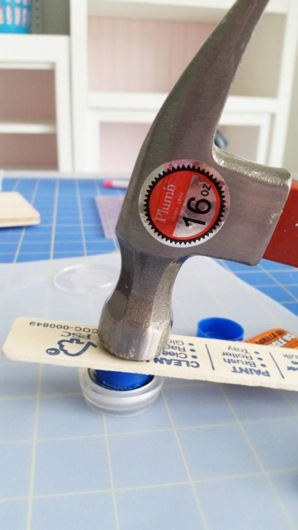 DIY Fabric Covered Buttons Tutorial with Tips - use Stick with Pusher and Hammer in the back in mold