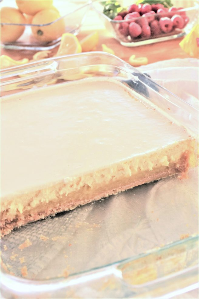 Cut and Serve Your Lemon Sour Cream Cheesecake Layered Dessert Bars with Lemon Oreo Crust Treats - Recipe via Dreaming in DIY