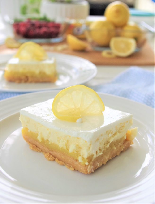 Lemon Sour Cream Cheesecake Dessert Bars with Lemon Oreo Crust - Easy Layered Treats Recipe by Dreaming in DIY #lemondesserts #lemonbars #easylemonbars #lemoncheesecakebars #cheesecakebars #easydesserts #simpledesserts #simplerecipes #simpledessertrecipes