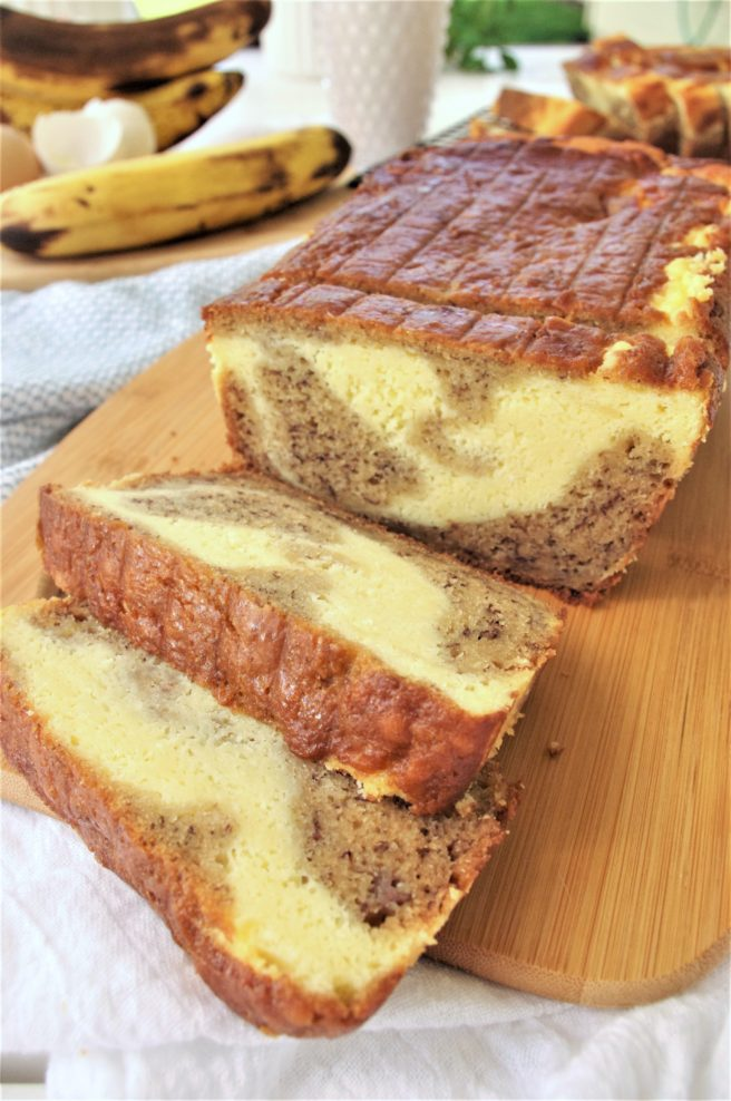 Easy Quick Cream Cheese Swirled Banana Dessert Bread made with Greek Yogurt Recipe - so moist and yummy - This is the BEST banana bread franken recipe we've ever conjured up (and we've tried a bagillion and a half). It turns out with perfect yummy texture and flavors. To tip the scales from delish to perfection - it's swirled with scrumptious cream cheese filling elevating it from yummy snack to irresistible dessert status! by Dreaming in DIY #bananabread #bananabreadrecipe #creamcheesebananabread #creamcheesebananabreadrecipe #bread #easybread #easybananabread