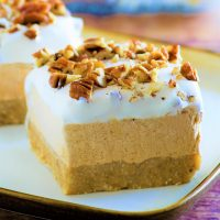 Pumpkin Spice Lush No Bake Layered Fall and Winter Dessert - Easy Recipe via Dreaming in DIY - Creamy and delicious and so easy to put together! The perfect dessert for Thanksgiving, Christmas and all your Fall and Winter Holiday dinner parties! #pumpkinspice #pumpkinlush #layeredpumpkindessert #pumpkindesserts